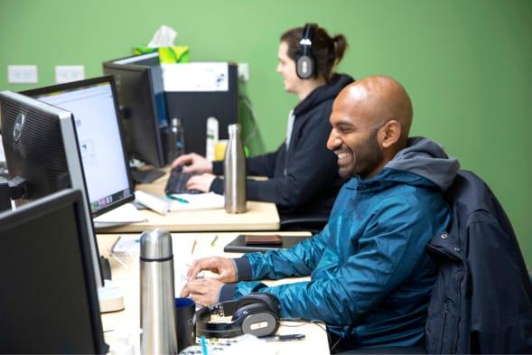Two men working independantly on adjacent desks